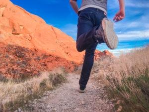 man-running-outside-along-desert-trail