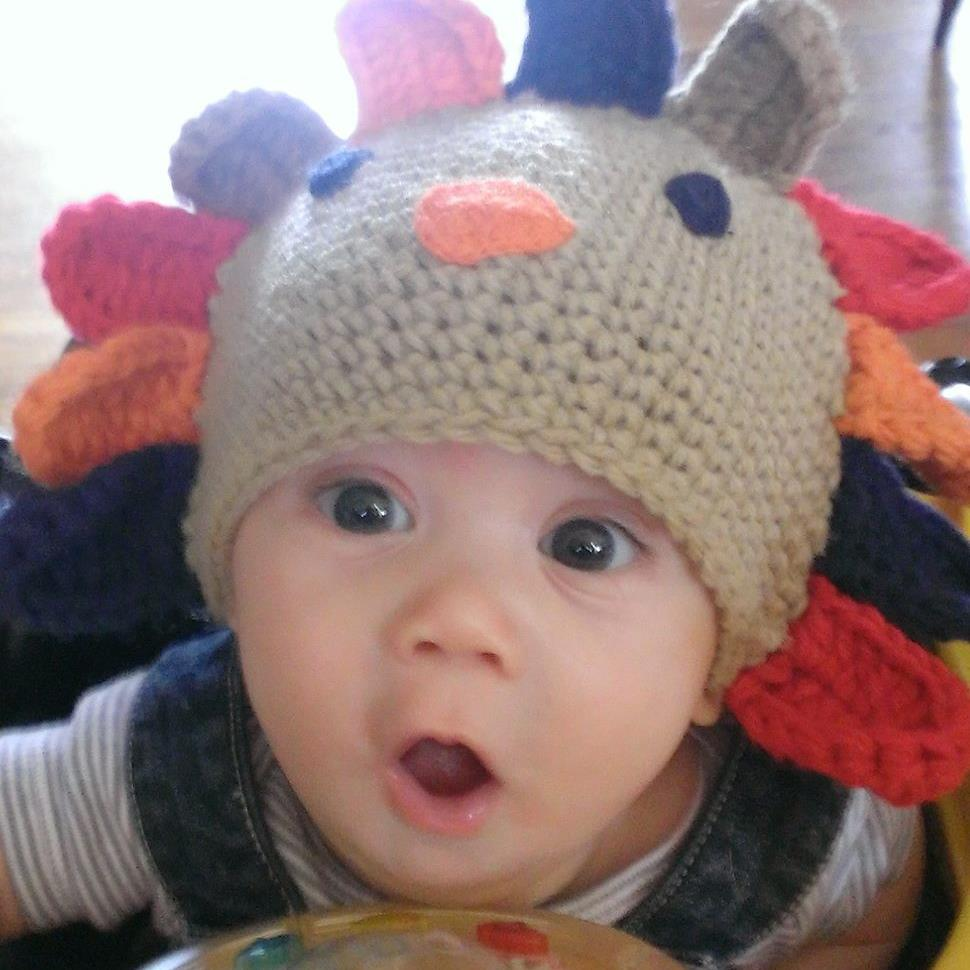 Brandon's 6-month-old son in a festive hat.